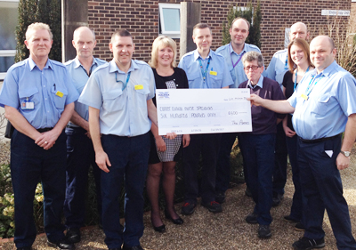 HOSPITAL PORTERS RAISE MONEY FOR CANCER SPECIALISTS
