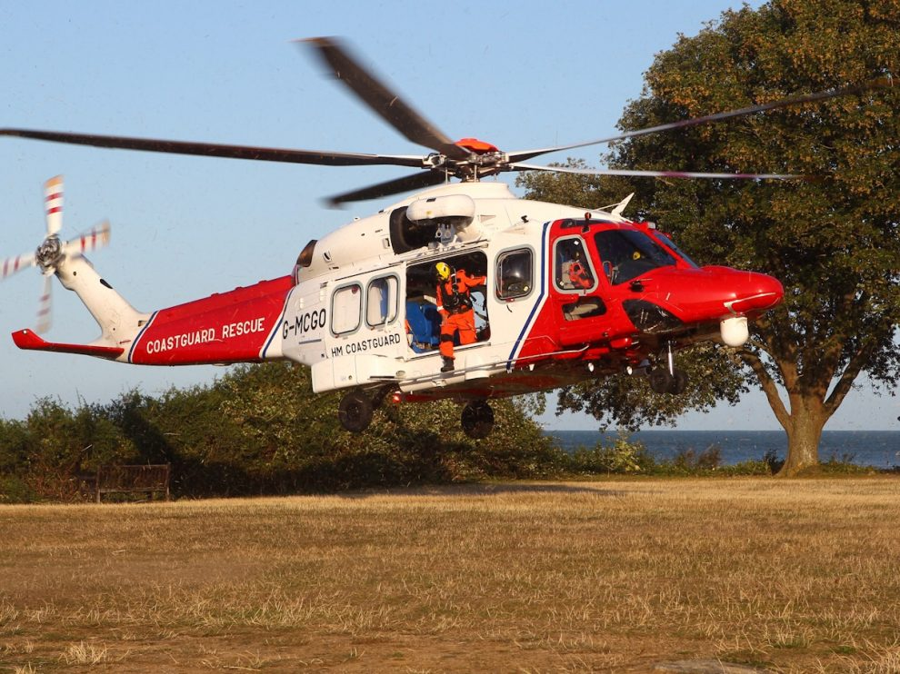 COASTGUARD HELICOPTER LANDS AT BEMBRIDGE TO AIRLIFT INJURED